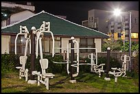Exercise equipment in yard at night, Seogwipo. Jeju Island, South Korea ( color)