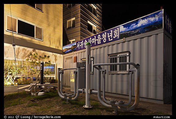 Public exercise equipment and buildings at night, Seogwipo. Jeju Island, South Korea (color)