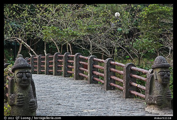 Footbridge and Dolharubang statues, Seogwipo. Jeju Island, South Korea (color)