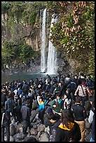 Crowd at the base of waterfall, Jeongbang Pokpo, Seogwipo. Jeju Island, South Korea (color)