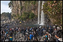Tourists at the base of Jeongbang Pokpo falls, Seogwipo. Jeju Island, South Korea ( color)