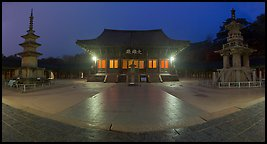 Frontal view of main hall and two pagodas at night, Bulguksa. Gyeongju, South Korea (Panoramic color)
