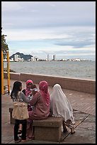 Women on waterfront. George Town, Penang, Malaysia (color)