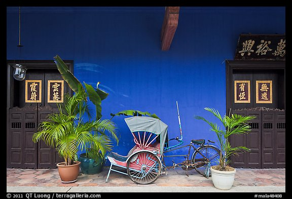 Trishaw and doors, Cheong Fatt Tze Mansion. George Town, Penang, Malaysia (color)