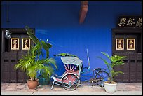 Trishaw and doors, Cheong Fatt Tze Mansion. George Town, Penang, Malaysia ( color)