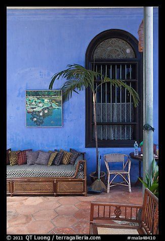 Chairs and blue wall, Cheong Fatt Tze Mansion. George Town, Penang, Malaysia (color)