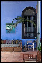 Chairs and blue wall, Cheong Fatt Tze Mansion. George Town, Penang, Malaysia ( color)