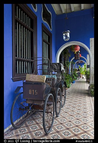 Rickshaws in front gallery, Cheong Fatt Tze Mansion. George Town, Penang, Malaysia