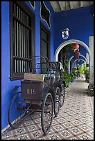 Rickshaws in front gallery, Cheong Fatt Tze Mansion. George Town, Penang, Malaysia ( color)