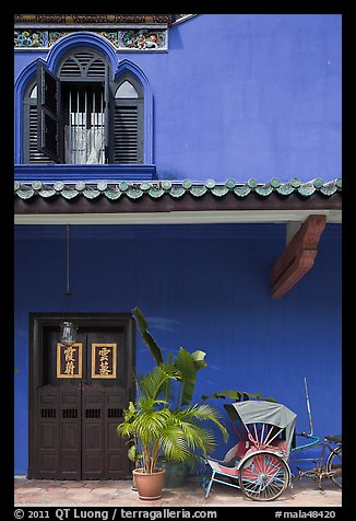 Window, door, and trishaw, Cheong Fatt Tze Mansion. George Town, Penang, Malaysia (color)