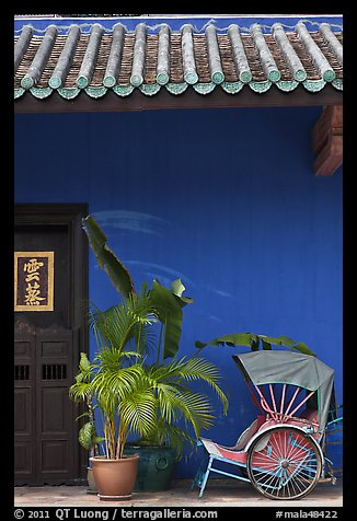 Trishaw, door, and roofing, Cheong Fatt Tze Mansion. George Town, Penang, Malaysia (color)