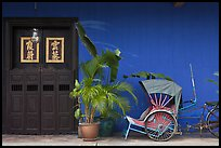 Trishaw, plant and door, Cheong Fatt Tze Mansion. George Town, Penang, Malaysia ( color)
