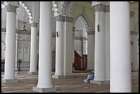 Man in prayer inside Masjid Kapitan Keling mosque. George Town, Penang, Malaysia