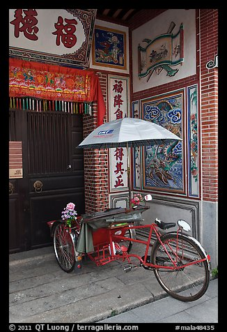 Bicycle rickshaw at temple entrance. George Town, Penang, Malaysia (color)