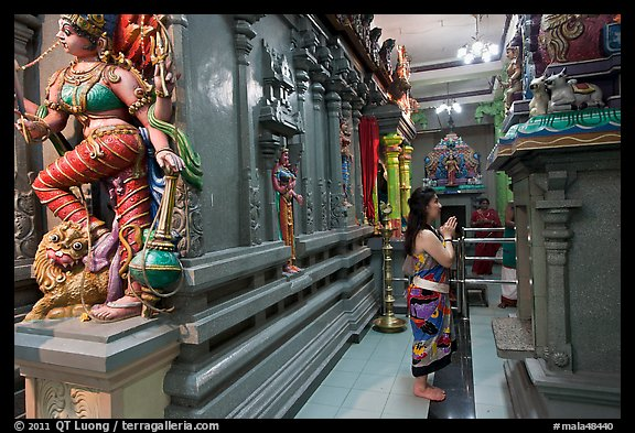 Woman worshipping at Sri Mariamman Temple. George Town, Penang, Malaysia (color)