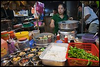 Woman serving dumplings. George Town, Penang, Malaysia (color)
