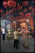 Worshiping inside goddess of Mercy temple. George Town, Penang, Malaysia ( color)