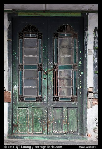 Old green door locked with chain. George Town, Penang, Malaysia (color)