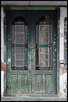 Old green door locked with chain. George Town, Penang, Malaysia