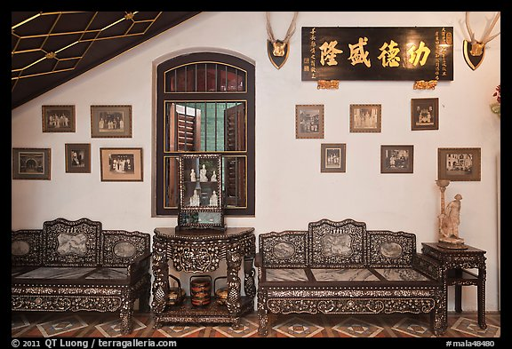Antique furniture and images, Pinang Peranakan Mansion. George Town, Penang, Malaysia