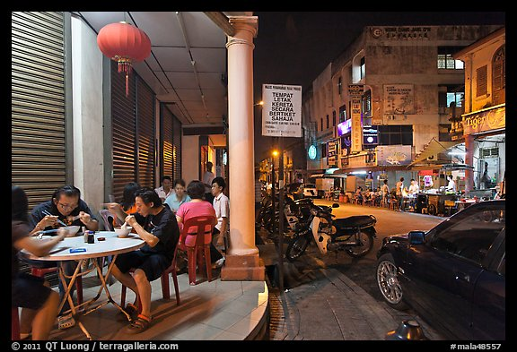 Eating on the street at night. George Town, Penang, Malaysia