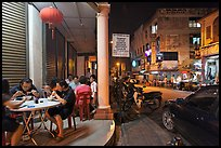 Eating on the street at night. George Town, Penang, Malaysia ( color)