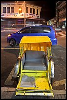 Rickshaw and auto at night. George Town, Penang, Malaysia ( color)