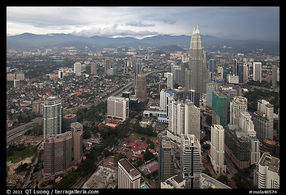 Elevated cityscape view with Petronas Towers. Kuala Lumpur, Malaysia (color)