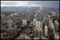 Elevated cityscape view with Petronas Towers. Kuala Lumpur, Malaysia ( color)