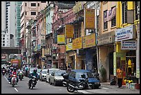 Motorcyles and shops, Little India. Kuala Lumpur, Malaysia ( color)