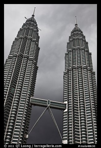 Petronas Towers (tallest twin towers in the world) and stormy sky. Kuala Lumpur, Malaysia (color)