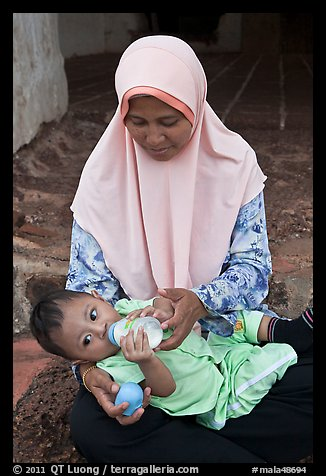 Mother and infant, St Paul Hill. Malacca City, Malaysia
