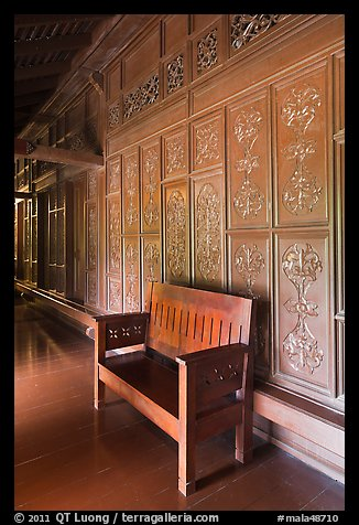 Wood panel and chair, sultanate palace. Malacca City, Malaysia