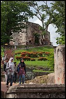 Malay tourists descend stairs from St Paul Hill. Malacca City, Malaysia (color)
