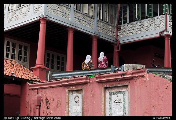 Stadthuys detail with two women. Malacca City, Malaysia (color)