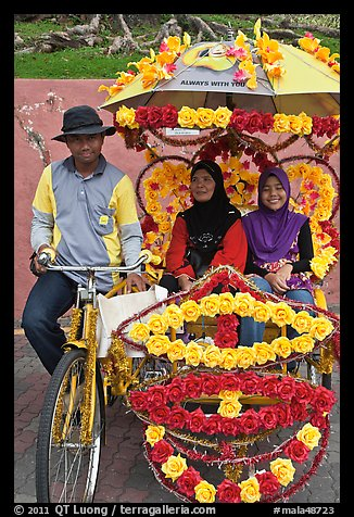 Rider and two women passengers, bicycle rickshaw. Malacca City, Malaysia (color)