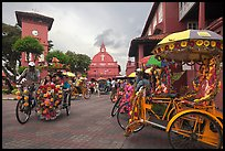 Trishaws, clock tower, and church. Malacca City, Malaysia ( color)