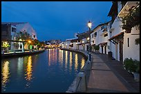 Houses and walkway at dusk, Melaka River. Malacca City, Malaysia (color)