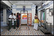 Worhipers and holy man, Sri Poyyatha Vinayagar Moorthi Temple. Malacca City, Malaysia (color)