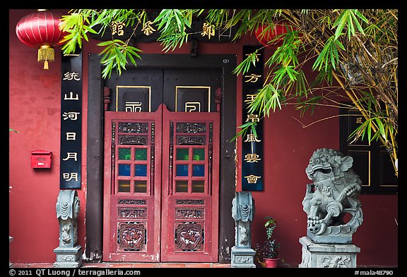 Chinese house entrance with lion sculpture and lanterns. Malacca City, Malaysia (color)