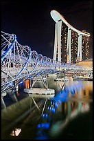 Helix Bridge and Marina Bay Sands hotel at night. Singapore (color)