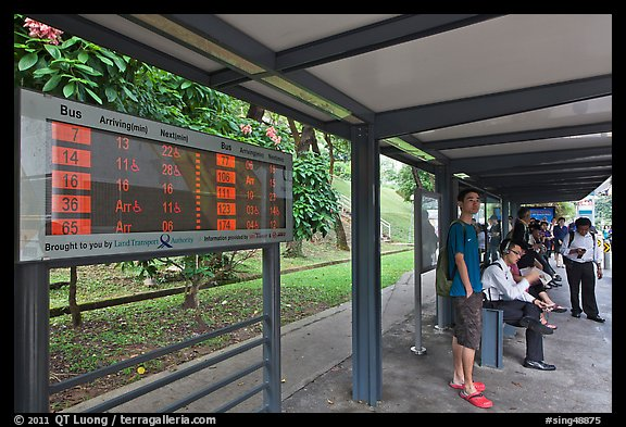 Bus stop with displays with expected wait time. Singapore (color)