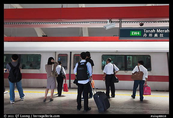 Passengers preparing to board MRT train. Singapore