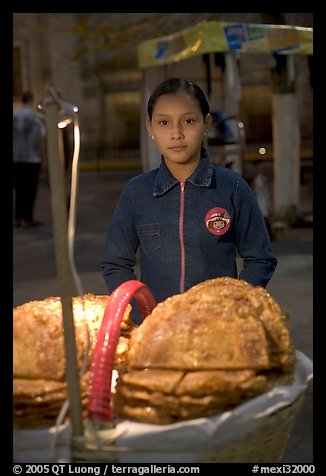 Young street food vendor by night. Guadalajara, Jalisco, Mexico