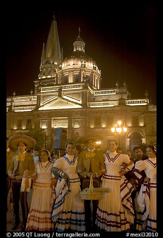 Men and women in traditional mexican costume with Cathedral in background. Guadalajara, Jalisco, Mexico (color)