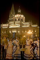 Men and women in traditional mexican costume with Cathedral in background. Guadalajara, Jalisco, Mexico