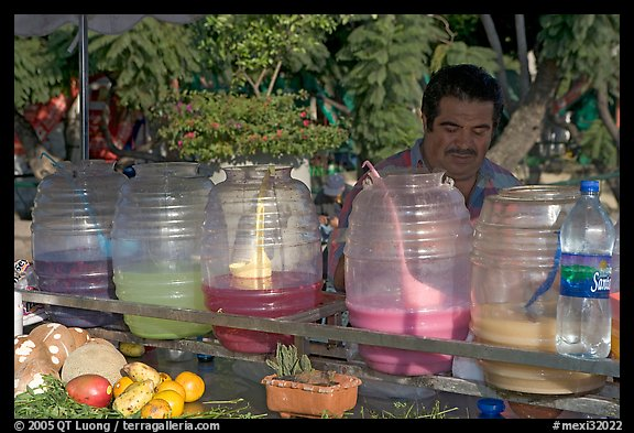 Multicolored drinks offered on a street stand. Guadalajara, Jalisco, Mexico (color)