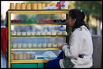Woman selling dairy desserts on the street. Guadalajara, Jalisco, Mexico ( color)