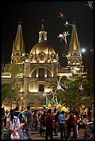 Children play with inflated balloons behind the Cathedral by night. Guadalajara, Jalisco, Mexico ( color)