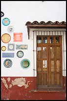 Wall decorated with colorful ceramic pieces, Tlaquepaque. Jalisco, Mexico ( color)